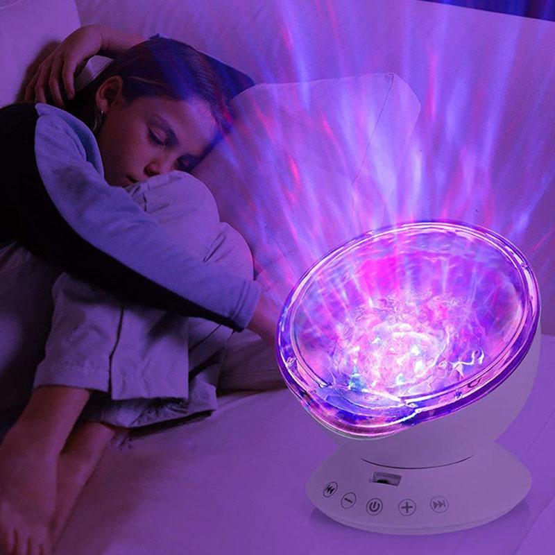 Veilleuses pour les enfants, projecteur télécommandé Ocean Wave LED et veilleuse 7 couleurs avec mini lecteur de musique intégré